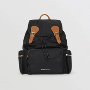 Inspired by military archive bags, our timeless backpack in showerproof nylon and finished with topstitched leather trims