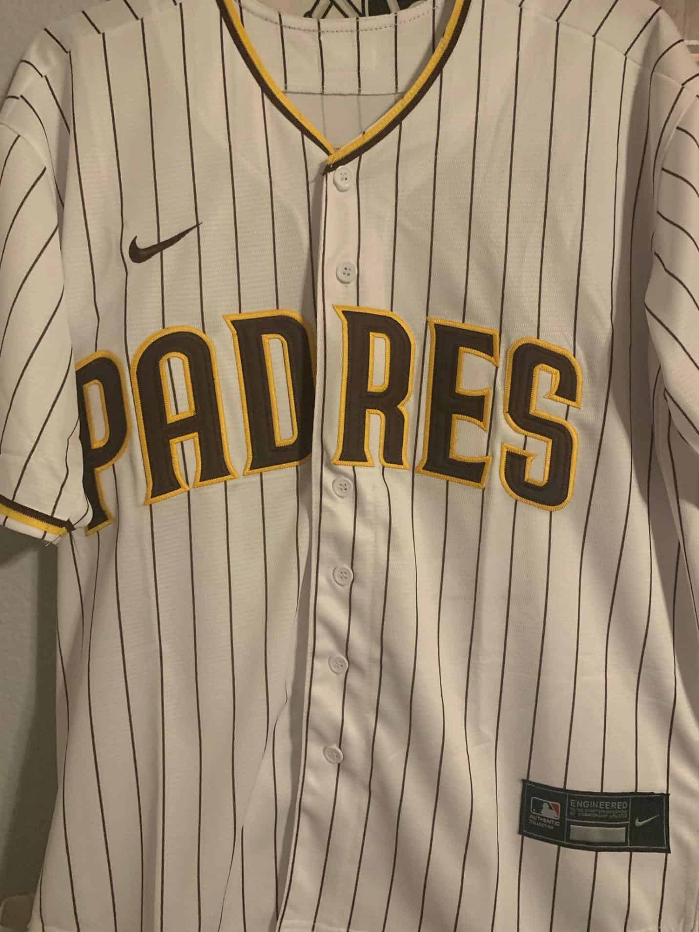 Padres White Pinstripe Baseball Jersey mbl jerseys real vs fake how tell the difference. notice the stitching, the prints, the colors palette, the wordings fonts the collar and sleeves